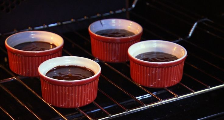 Dark Chocolate Cakes: Lovely, moist, portion-sized chocolate cakes that are served hot and topped with hot chocolate sauce. From Andreas Viestad @ newscancook.com.