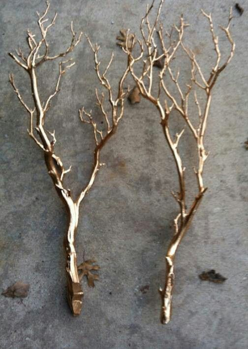 Spray paint branches as a centerpiece. Love the gold color.