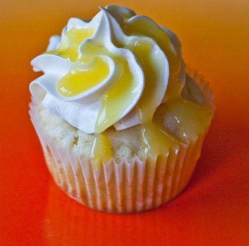 Lemon cupcakes topped with lemon Italian meringue buttercream and lemon curd.