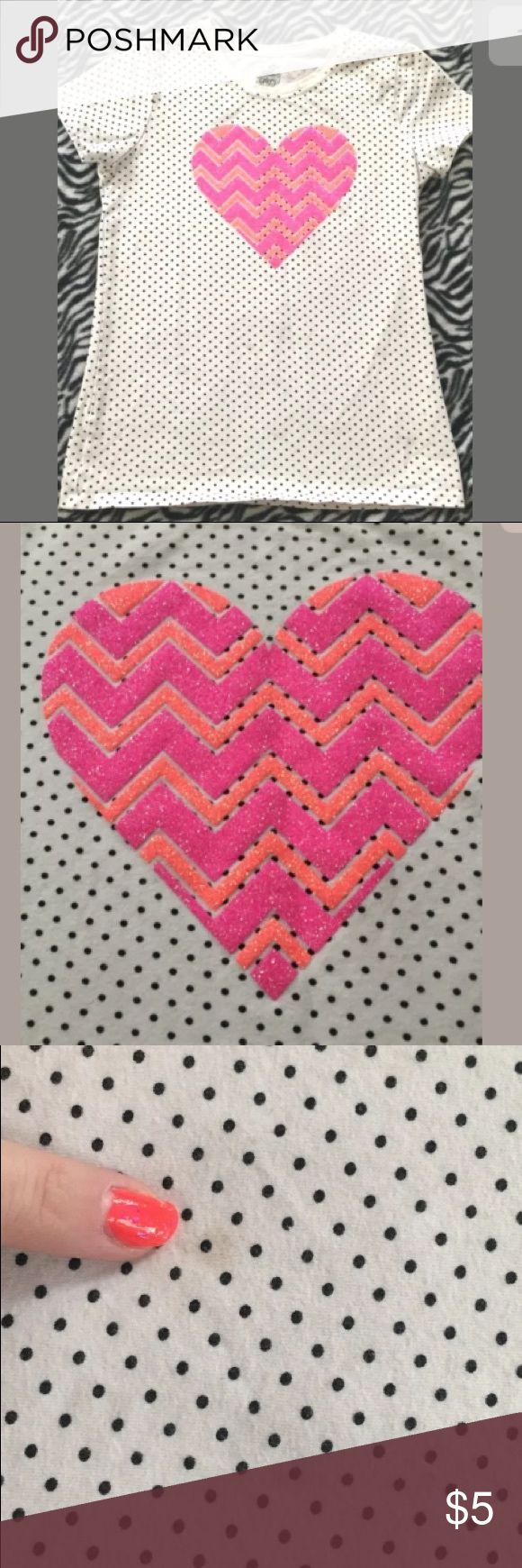 🛍5 for $25🛍 White Polka Dot Pink Chevron Top BRAND: Faded Glory SIZE:  10 / 12 DESCRIPTION: White fitted tee with black polka dots and Glitter pink and orange chevron heart. CONDITION: Great condition with minor fading from wash and wear. Very small stain on front ( as noted in picture) Shirts & Tops Tees - Short Sleeve