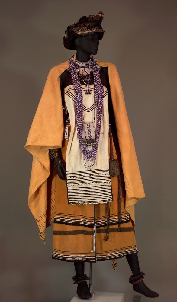 Africa | Young Matron's outfit from the Mfengu people, Eastern Cape, South Africa | Cloth, leather, beads, metal, rubber on mount, from crown of hat to bottom of skirt
