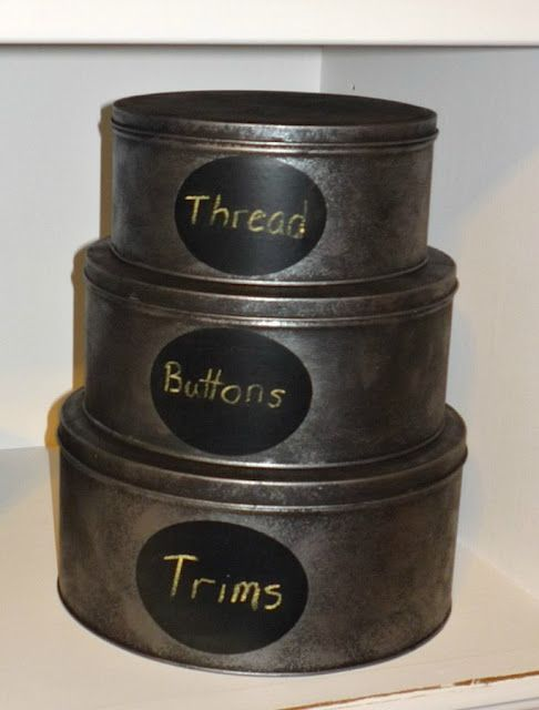 Re-use old cookie tins add chalkboard paint in the center for easy label changing.