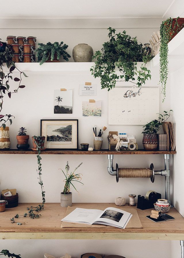 Beautiful Work Space With A Large Desk And Shelves Containing Plants And  Art. Gallery
