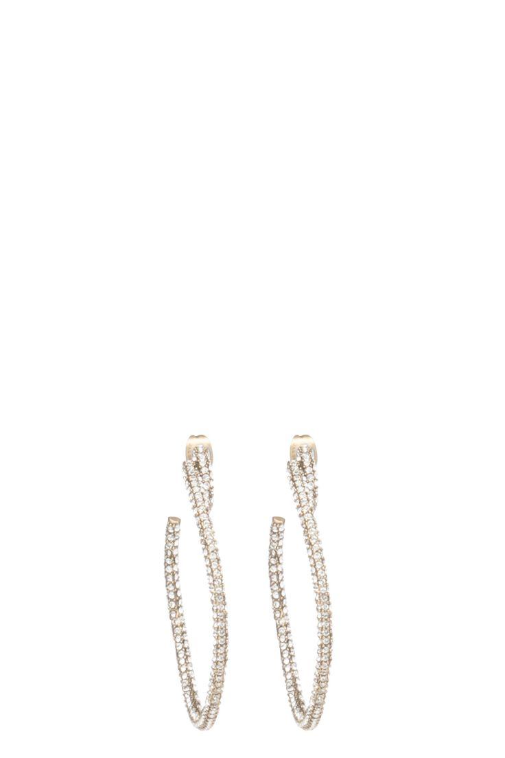 The Marc Jacobs Pavé Large Twisted Hoops are extremely sparkling and glamorous with a simple hoop shape covered in pave stones. A twisted end near post backings is a literal Marc Jacobs twist. Style them for special occasions for a high-watt look. //65% BRASS 30% SW STONE 5% TITANIUM POST//