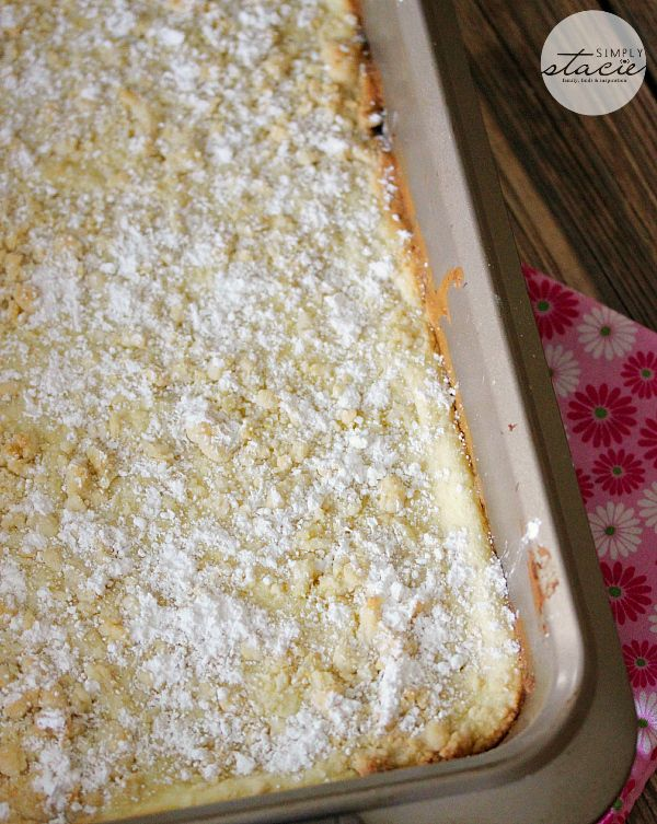 French Vanilla Cream Bars - a cake mix hack! The bottom layer is a French vanilla cookie crust, topped with a sweet creamy cheesecake filling. It's finished off with French vanilla cookie bits and powdered sugar.