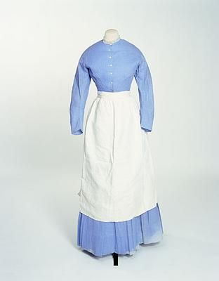 Servant's Dress, 1865. England. Blue cotton muslin with white apron.