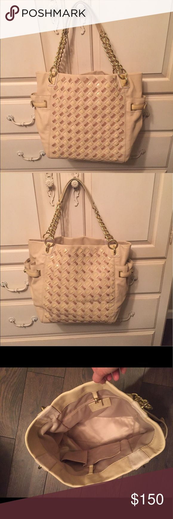 Gorgeous Coach leather tote Nude leather barely used tote with beautiful weaved detail on both sides. Gold chain link straps with 7.5 inch drop. Dimensions: 11.5 inches x 15.25 inches x 5.5 inches. Two side exterior pockets, one interior zip pocket, two interior slip pockets. Coach Bags Totes