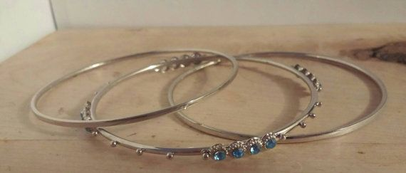 Check out this item in my Etsy shop https://www.etsy.com/ca/listing/484216432/silver-bangle-set-with-blue-topaz