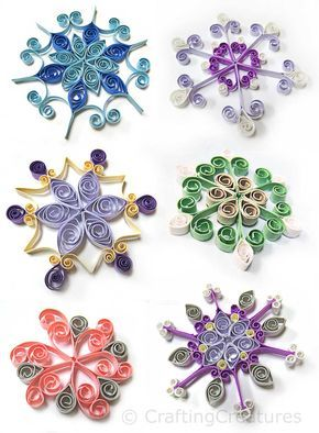 Quilled snowflakes with a free snowflake grid to help make your snowflakes even.