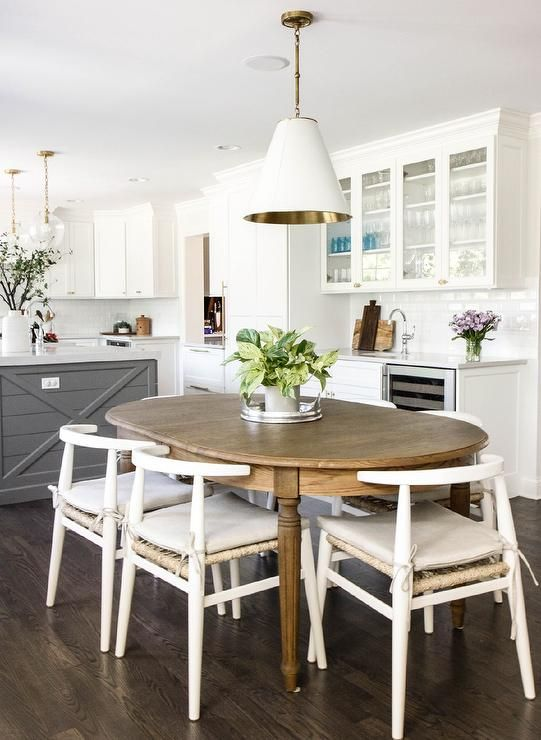 Oval French dining chairs with white wishbone chairs