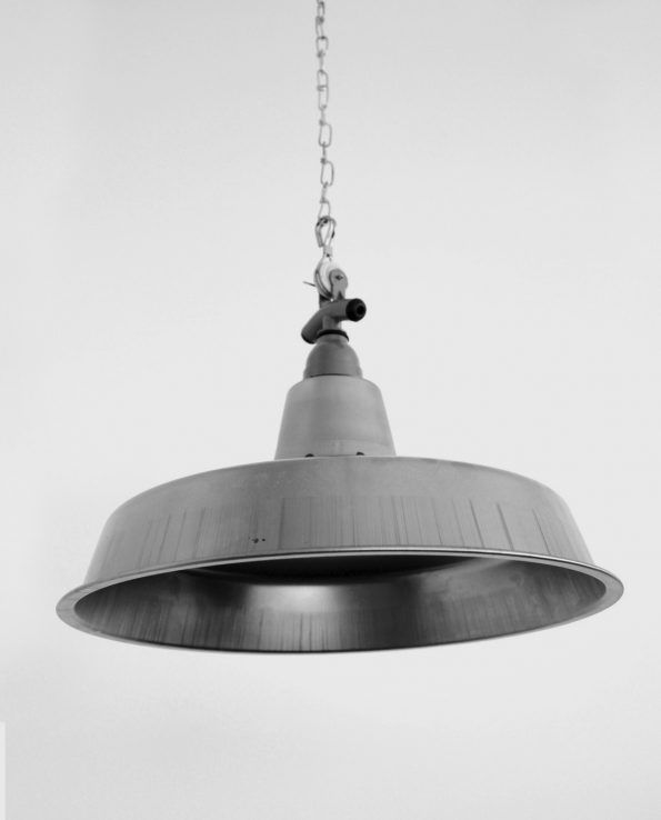 Workshop (Raw) This traditional 1940s workshop style light shade has crisp lines and a shallow shade to suit a variety of spaces. The raw and unpainted cold-spun steel will rust up if left unoiled which allows for a great vintage look.