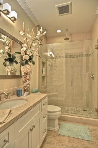 nicely remodeled small bathroom...there wouldnt be a huge vase with flowers...and thered be more color