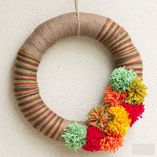 For those holiday decorators who love to customize their creations, this DIY yarn wreath is for you. Simply wrap a straw wreath with complementary colors of yarn; the longer you wrap with a color, the thicker the stripe. Finish with a cluster of yarn pom-poms, and your front door will be this season's star./