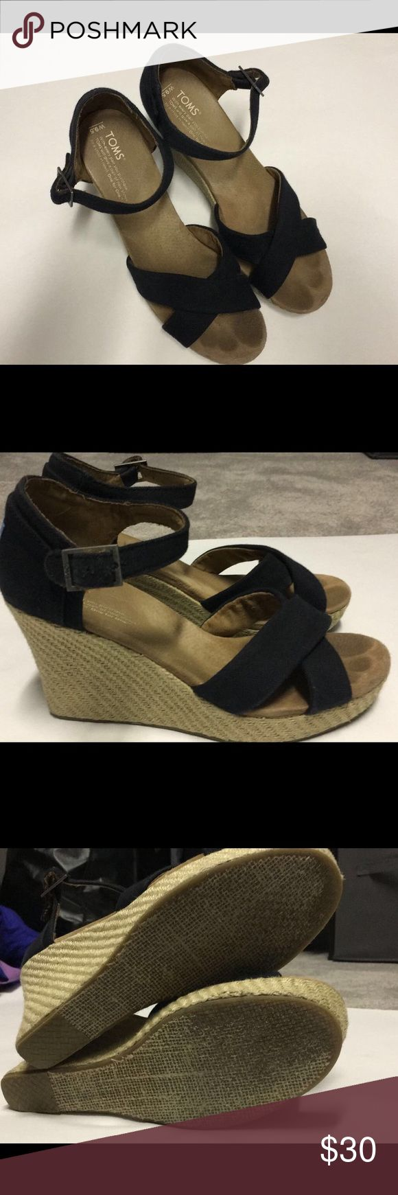 TOMS wedges TOMS wedge in black size 9.5. Runs true to size. Previously worn but shows very little signs of wear. TOMS Shoes Wedges