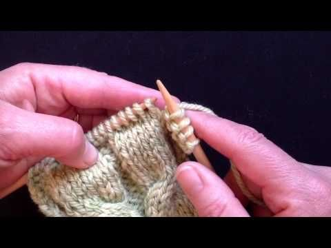 Tightening loose knit stitches in rib and cables. Wrapping purl stitches in t...