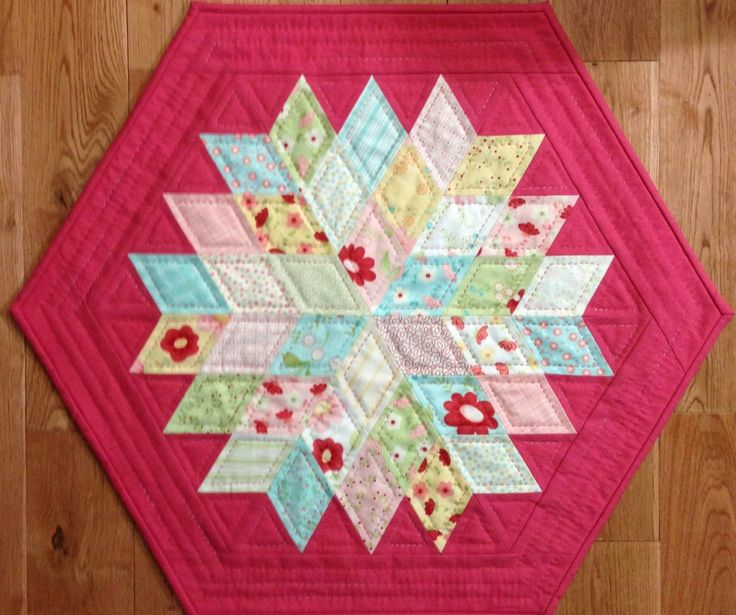 """""""Rock Candy"""" by Jaybird Quilts. Charm pack friendly. The 2"""" finished diamonds are cut using """"Sidekick"""" ruler also by Jaybird Quilts.  Measures 20.5"""" x 23""""."""