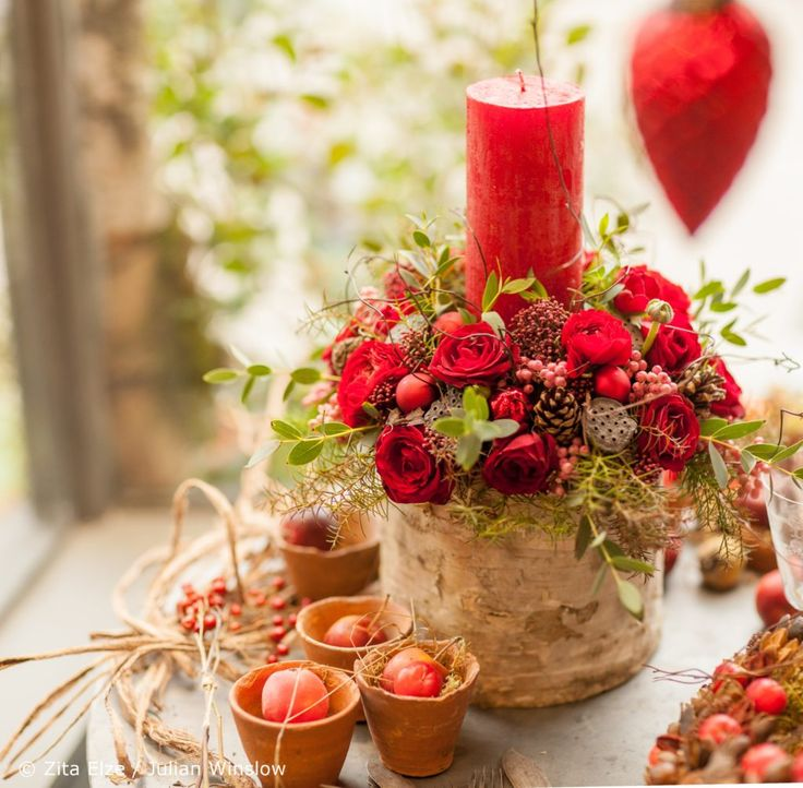 Zita Elze flower shop Kew Christmas silver birch candle holder in with red roses, berries and festive foliage photo: Julian Winslow lp 24