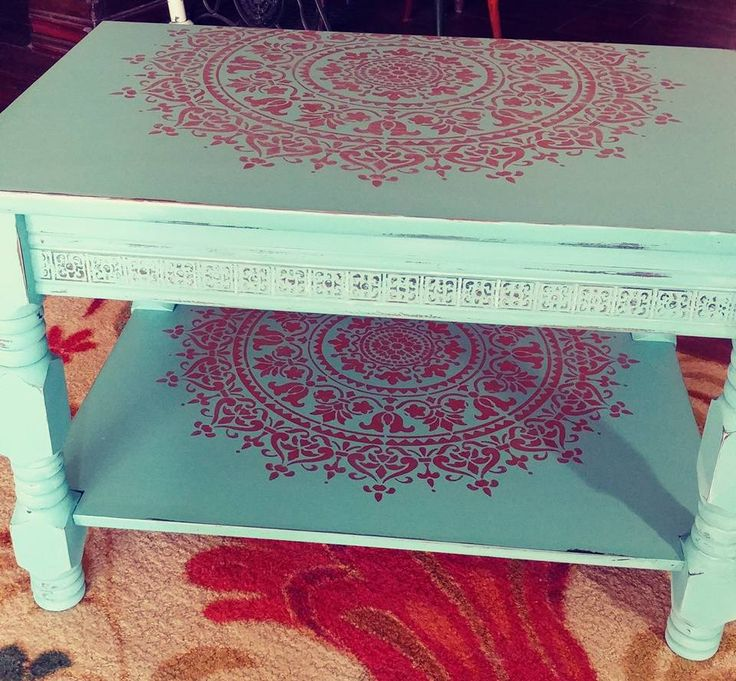A teal and metallic copper DIY stenciled and painted coffee table makeover using the Prosperity Mandala Stencil from Cutting Edge Stencils. http://www.cuttingedgestencils.com/prosperity-mandala-stencil-yoga-mandala-stencils-designs.html
