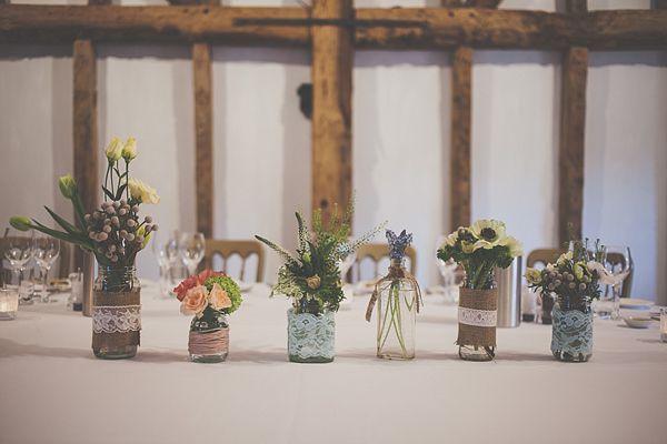 Flowers in jam jars.