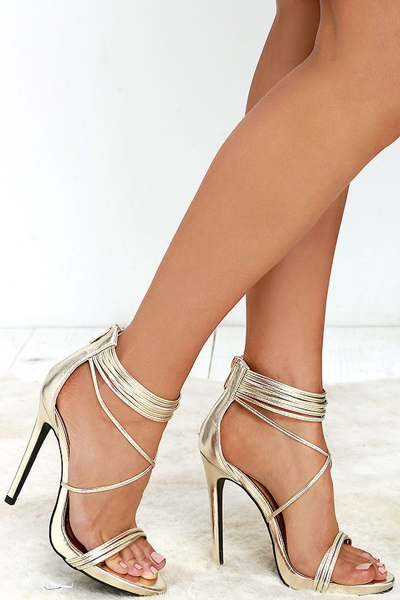 With a gorgeous show of dainty gold straps, the Haute and Heavy Gold Dress Sandals are worth their weight in gold! Vegan leather crisscrosses at the vamp, merging into a strappy ankle cuff and zippered heel cup.