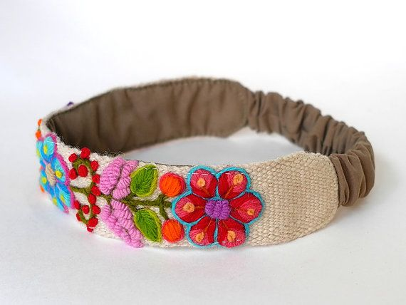 Embroidered Headband    Hand embroidered wool headband, the material used is sheep wool. The flowers are hand embroidered sheets. Each headband is