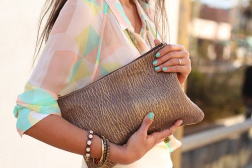 pastel blouse and brown leather clutch bag