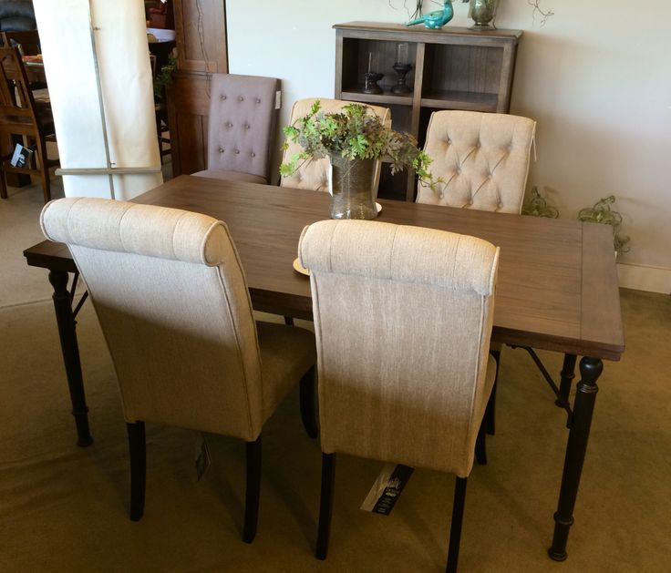 The Combination Of Metal And Wood Give This Dining Group A Very Unique Look What ShowroomDining TableDining Room