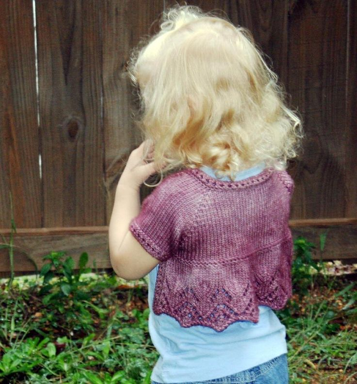 I was looking for a shrug/cardigan, but with something extra special.Suzanne Elizabeth has a lace back, and is a cross between a shrug and open cardigan.This will be just as cute with a pair of jeans, as it will over a fancy dress.You have the choice of either long, ¾ length, or short sleeves, and this is knit top down.The lace is charted and written out.The body is knit flat and the sleeves are knit in the round.Yarn weightWorsted / 10 ply (9 wpi) ? Gauge20 stitches = 4 inchesNeedle sizeUS…