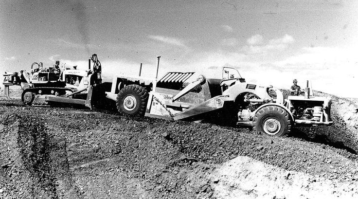 Feast Contractors loading rotten rock in the hills of Wellington, 1970. This particular machine is a model 7UOT with the 4-speed Allison transmission. TS-14's were in their natural element in goat country!