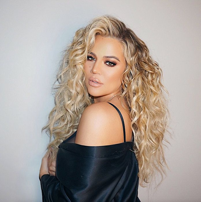 """Pregnant Khloé Kardashian Is """"Officially Six Months"""" Along: See Her Latest Baby Bump-Hugging Look 