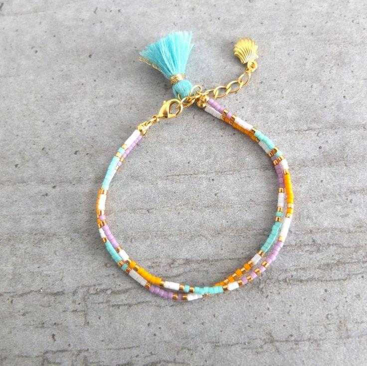 Le produit Bracelet coloré Bohème en double apprêts dorés est vendu par My-French-Touch dans notre boutique Tictail.  Tictail vous permet de créer gratuitement en ligne une boutique de toute beauté sur tictail.com