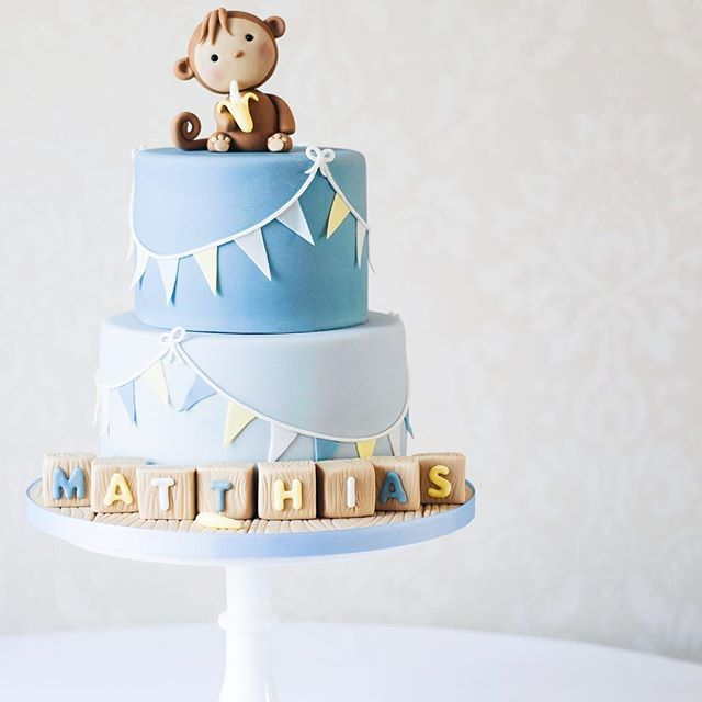Super cute Christening cake featuring a sweet little monkey obviously eating a banana!
