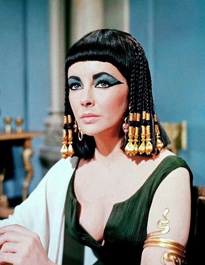 "Elizabeth Taylor plays Cleopatra in the 1963 film ""Cleopatra."" Explore ""the 18 best makeup moments from movies and TV"" with Lucky Magazine. (photo: 20th Century-Fox Film Corp./Courtesy Everett Collection)"