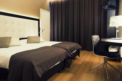 Het Hotel Saint-Nicolas biedt driepersoonskamers en het is mogelijk om een kinderbed bij te plaatsen.