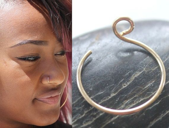BECAUSE WHO NEED PAIN ? NO ONE WILL KNOW ITS NOT GOING THOUGHT YOU NOSE.  THE MODEL IS WEARING 22g, ROSE GOLD, SIZE 7mm  Sterling Silver - Rose