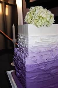 Ruffled purple ombre wedding cake with hydrangeas