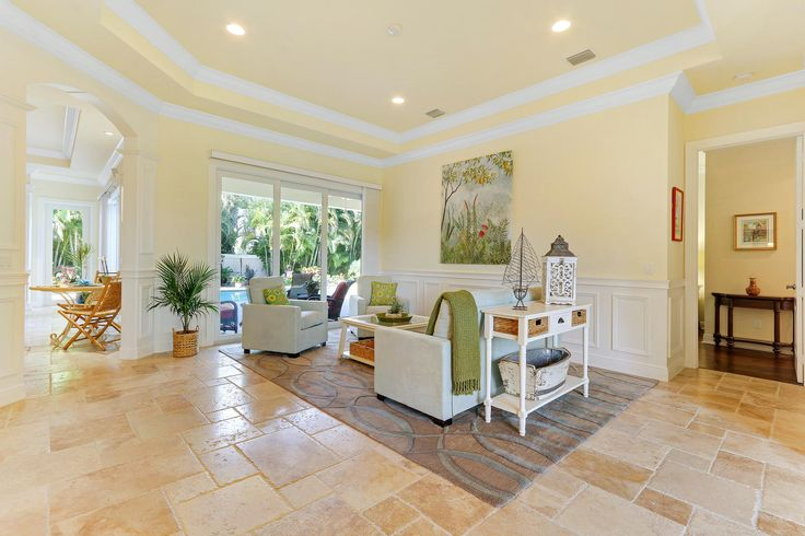 This room housed a pool table and dark furniture; buyers found it confusing!  Staged to scale and to incorporate inspiration painting colors.  End result: an uplifting room that is harmonious with the home and satisfies the need for a formal space (customer's own rug)