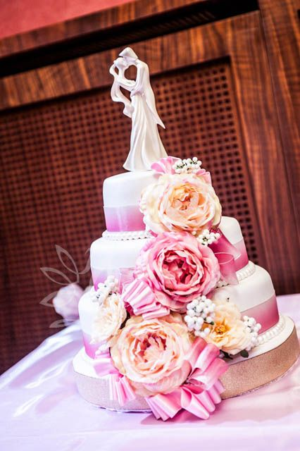 #Wedding #cake in pink with artificial flowers and Bride & Groom figures on the top. Taste even better than the look. From our real Impuls wedding on May, 2014.