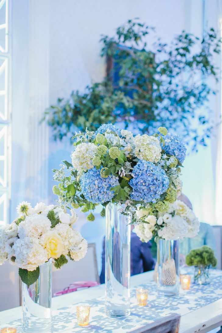 Tall blue and white hydrangea centerpieces fox events