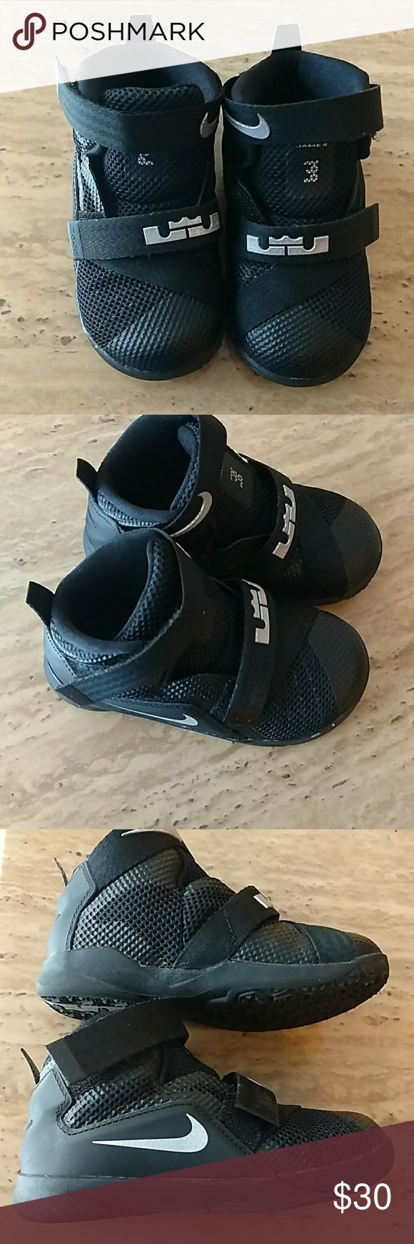 LeBron James Nike Shoes Black LeBron James Soldier 10 Shoes. They have Velcro Straps across the front. LeBron James symbol and Nike sign is grey. Only worn once. Were too small. Nike Shoes Sneakers