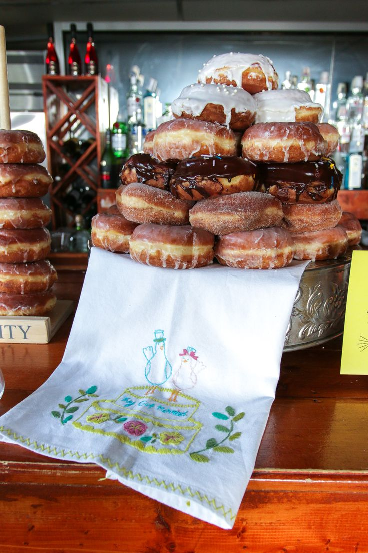 Wedding Cake made up of District Donuts in New Orleans, LA by @beckysuebakes