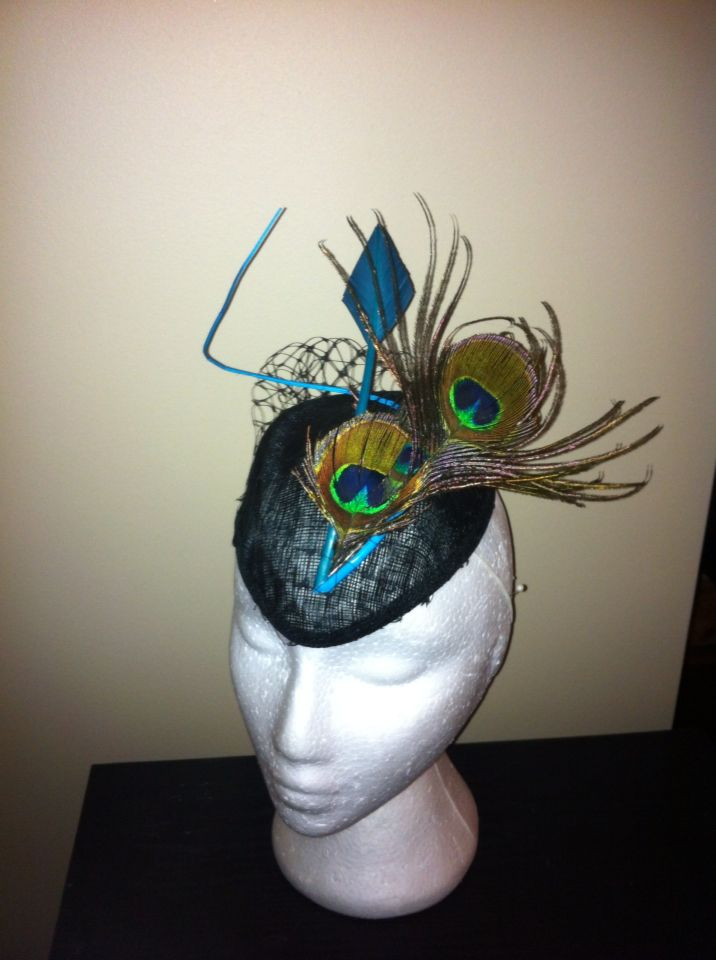 Black base with peacock feather, teal quill and ostrich feather.
