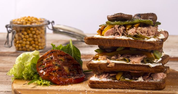 Grilled vegetables and tuna sandwich. A great sandwich with grilled bell peppers, mushrooms, tuna and a cheese spread over toasted bread. The perfect filling sandwich for any time of the day.