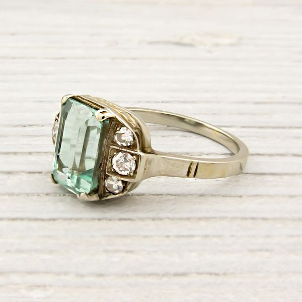 A vintage emerald engagement ring made of white and yellow gold. Centered with an approximate one CARAT light emerald with amazing clarity and accented with single cut diamonds. Can be sized to suit any finger Circa 1930 #ErstwhilePintoWin