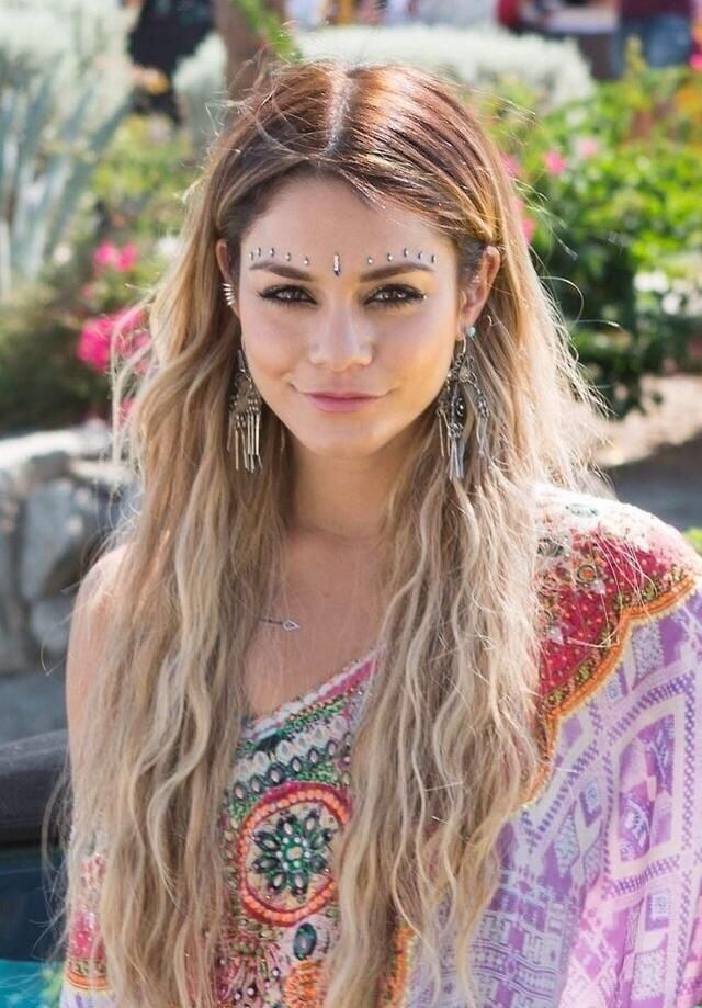 If you don't already know, Vanessa Hudgens tends to basically live and breathe bohemian lifestyle. She is always posting pictures to social media showing her latest adventures and amazing fashion! The look she has for this post is very authentic and unique with the face paint and middle part in her hair! LOVE IT: