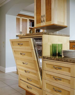 Dishwasher raised higher to cut down on bending and custom front panel to blend in with the rest of the cabinetry.
