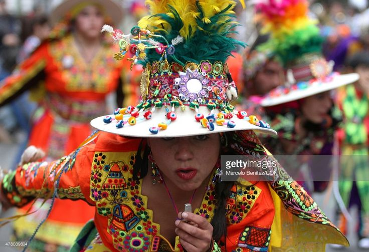 """A woman of an Andean community dances on the street during 'Inti Raymi"""" (in English: Sun's Party) celebration on June 21, 2015 in Valparaiso, Chile. Inti Raymi is the Andean people celebration of their New Year that matches with the winter solstice. Andeans commemorate New Year with typical dances on the street."""