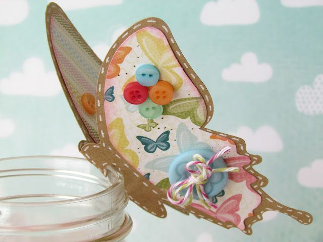 Butterfly embellishments with buttons and charm