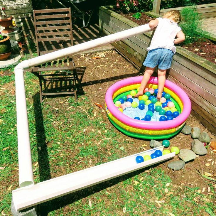 Our builders left behind lots of guttering and drain pipes. This was the perfect opportunity to build Miss 3 a shoot for her ballpit balls!  She had so much fun dropping the balls down the pipe and seeing them reappear at the other end! Will they or won't they pop out? Sometimes they got stuck and we had to send a tennis ball down to release them!  #creativeplayideas #preschoolphysics #outdoorplay #preschool #homeschool #thekidsplay #earlychildhood #earlychildhoodeducation #earlylearning ...