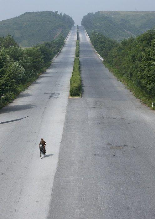 keep right: Long Roads, Korea Highway 160, Korea North, Bikes Trips, Northkorea, Places, Korean Highway, North Korean Border, Eric Lafforgue